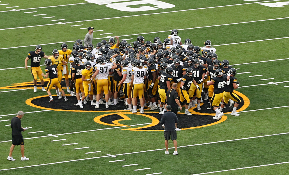 The Iowa Hawkeyes huddle on the Tigerhawk during Fall Camp Practice No. 12 at Kinnick Stadium in Iowa City on Thursday, Aug 15, 2019. (Stephen Mally/hawkeyesports.com)