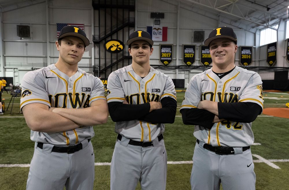 Iowa Hawkeyes pitchers Ben Probst (19), Jason Foster (27), and Trace Hoffman (42) pose for a photo during the team's annual media day Tuesday, February 5, 2019 in the Indoor Practice Facility. (Brian Ray/hawkeyesports.com)