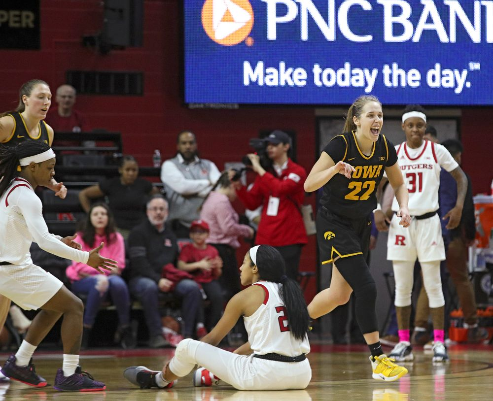 Iowa guard Kathleen Doyle (22) celebrates after a hold in the final seconds of the fourth quarter of their game at the Rutgers Athletic Center in Piscataway, N.J. on Sunday, March 1, 2020. (Stephen Mally/hawkeyesports.com)