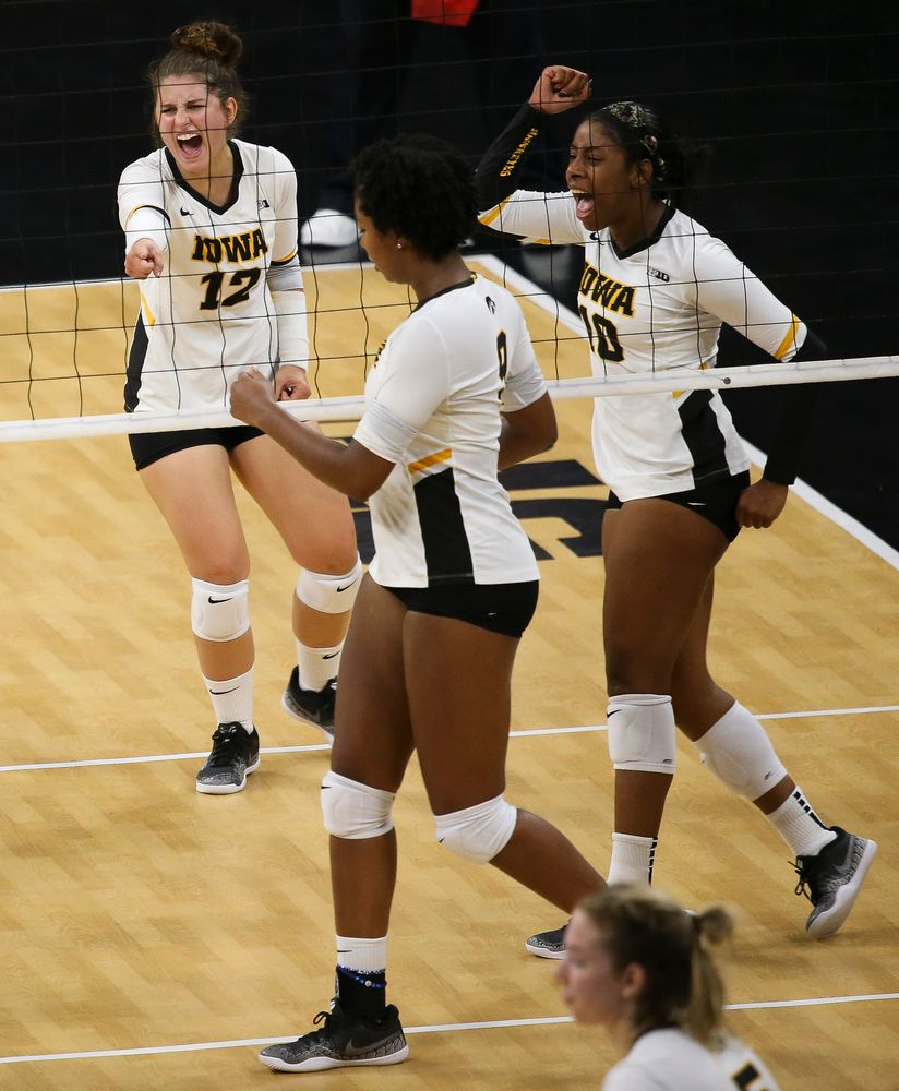 Iowa Hawkeyes defensive specialist Emily Bushman (12), Iowa Hawkeyes outside hitter Griere Hughes (10)