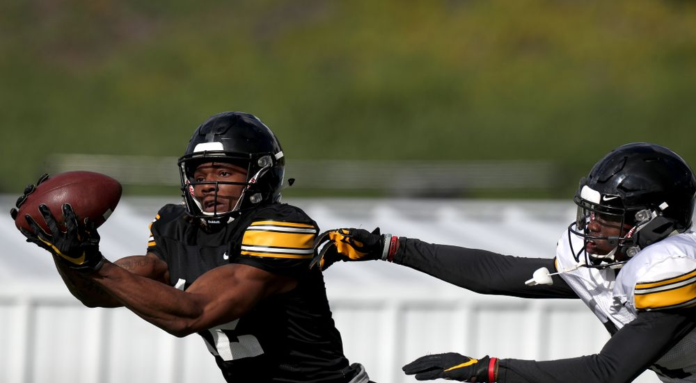 Iowa Hawkeyes wide receiver Brandon Smith (12) makes a catch during Holiday Bowl Practice No. 3  Tuesday, December 24, 2019 at San Diego Mesa College. (Brian Ray/hawkeyesports.com)