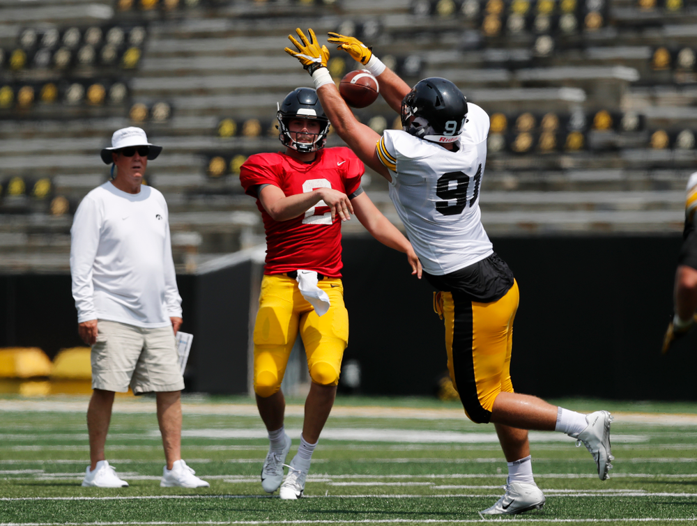 Iowa Hawkeyes quarterback Peyton Mansell (2) and defensive lineman Brady Reiff (91) during Kids Day Saturday, August 11, 2018 at Kinnick Stadium. (Brian Ray/hawkeyesports.com)