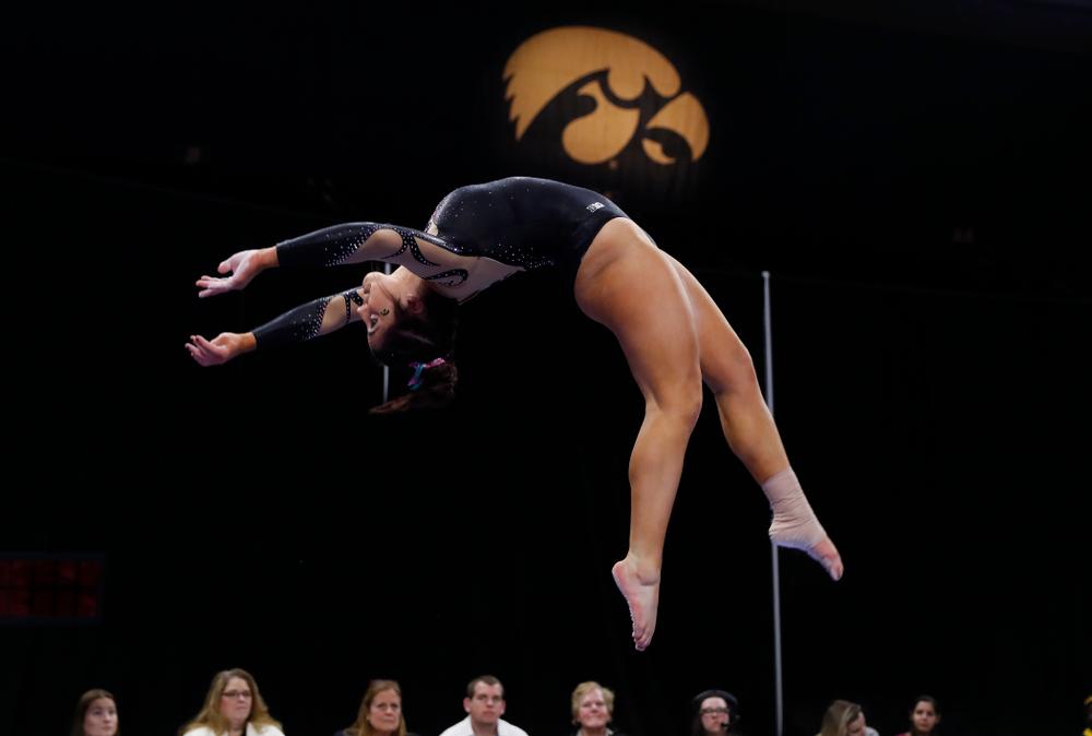 Iowa's Nikki Youd competes on the beam