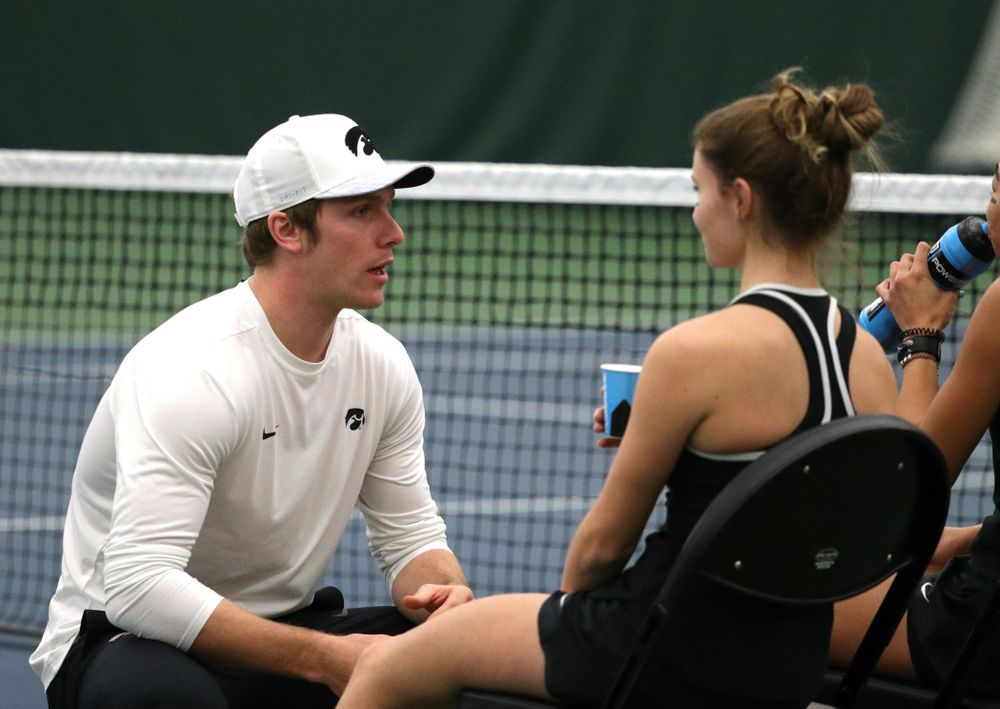 Assistant coach Daniel Leitner talks with Michelle Bacalla and Cloe Ruettte as they play a doubles match against the Penn State Nittany Lions Sunday, February 24, 2019 at the Hawkeye Tennis and Recreation Complex. (Brian Ray/hawkeyesports.com)
