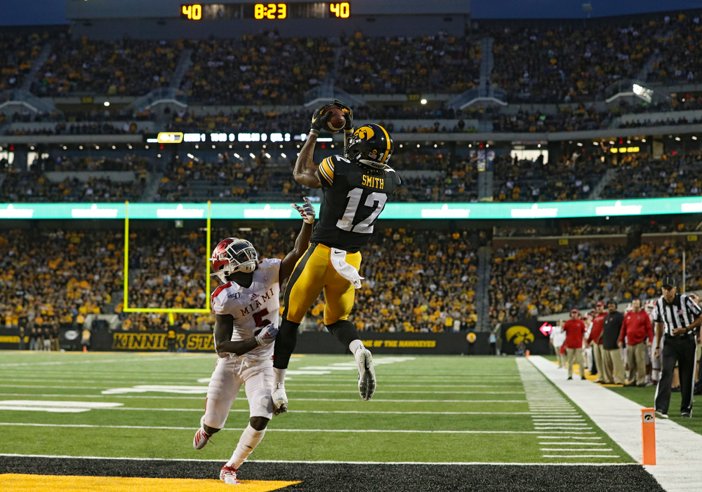 Iowa Hawkeyes wide receiver Brandon Smith (12) pulls in a 9-yard touchdown pass during the second quarter of their game at Kinnick Stadium in Iowa City on Saturday, Aug 31, 2019. (Stephen Mally/hawkeyesports.com)