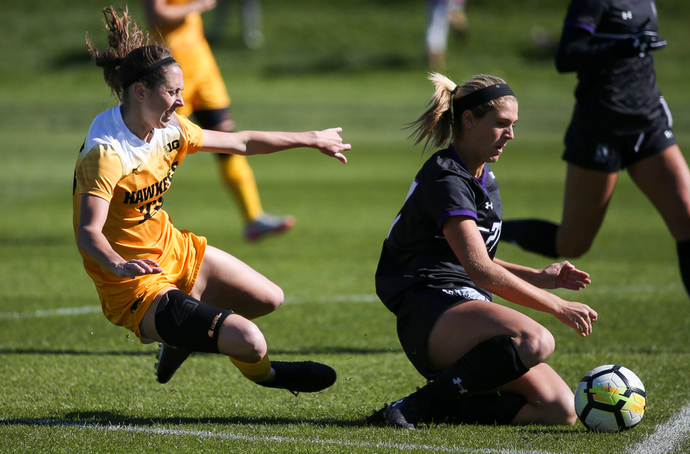 Iowa Hawkeyes midfielder Josie Durr (25) is fouled during a game against Northwestern at the Iowa Soccer Complex on October 21, 2018. (Tork Mason/hawkeyesports.com)