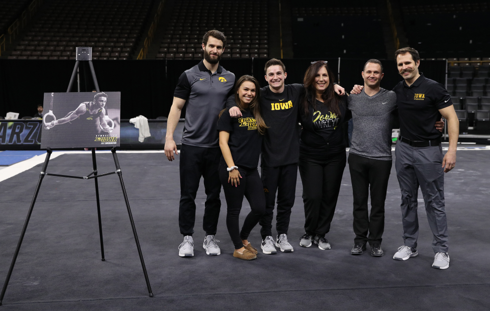 Iowa Men's Gymnast Jake Brodarzon and his family during senior day ceremonies following their meet against the Ohio State Buckeyes  Saturday, March 16, 2019 at Carver-Hawkeye Arena.  (Brian Ray/hawkeyesports.com)