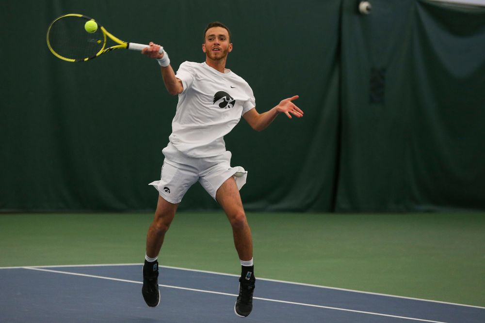 Iowa's Kareem Allaf hits a forehand during the Iowa men's tennis match vs Western Michigan on Saturday, January 18, 2020 at the Hawkeye Tennis and Recreation Complex. (Lily Smith/hawkeyesports.com)