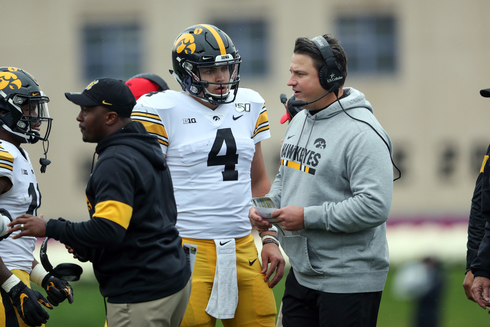 Iowa Hawkeyes quarterback Nate Stanley (4) and offensive coordinator Brian Ferentz  against the Northwestern Wildcats Saturday, October 26, 2019 at Ryan Field in Evanston, Ill. (Brian Ray/hawkeyesports.com)
