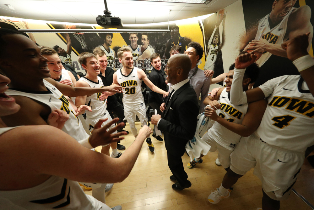 Iowa Hawkeyes assistant coach Sherman Dillard dances in the locker room following their victory over the Michigan Wolverines  Friday, February 1, 2019 at Carver-Hawkeye Arena. (Brian Ray/hawkeyesports.com)