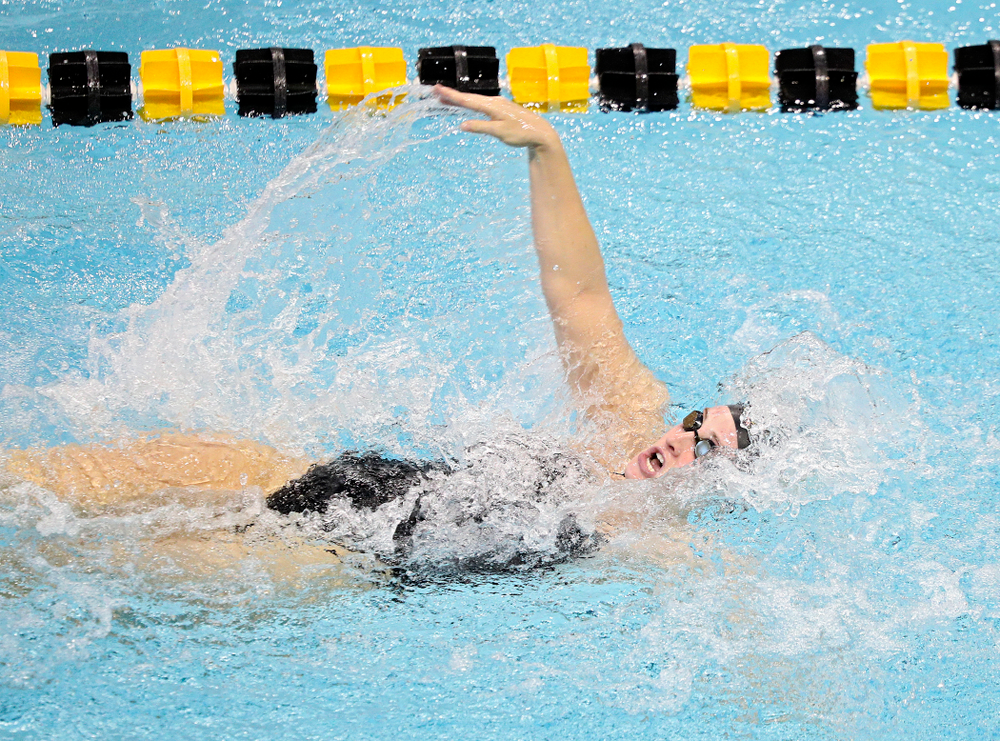 Iowa's Georgia Clark swims the women's 100-yard backstroke event during their meet against Michigan State and Northern Iowa at the Campus Recreation and Wellness Center in Iowa City on Friday, Oct 4, 2019. (Stephen Mally/hawkeyesports.com)