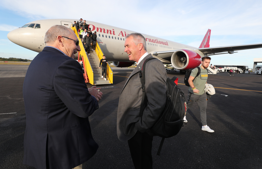 Henry B. and Patricia B. Tippie Director of Athletics Chair Gary Barta talks with Outback Bowl team host Bruce Poli  Wednesday, December 26, 2018 as the Iowa Hawkeyes arrive in Tampa, Florida for the Outback Bowl. (Brian Ray/hawkeyesports.com)