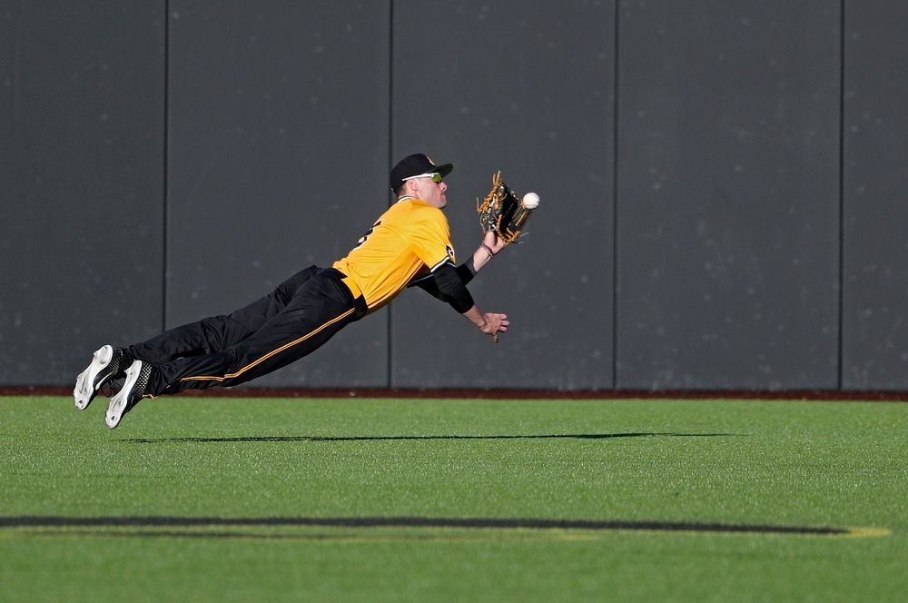 Iowa Hawkeyes center fielder Ben Norman (9) dives for the ball during the seventh inning of their game at Duane Banks Field in Iowa City on Tuesday, Apr. 2, 2019. (Stephen Mally/hawkeyesports.com)