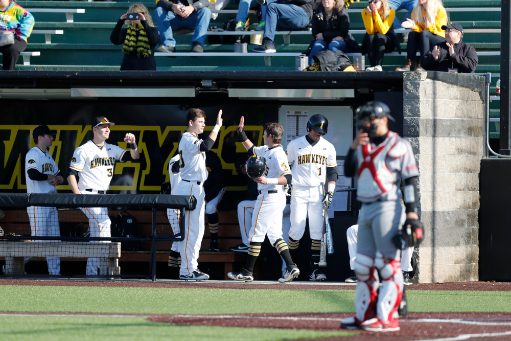 Iowa Hawkeyes infielder Mitchell Boe (4) and infielder Kyle Crowl (23) against Northern Illinois Tuesday, April 17, 2018 at Duane Banks Field. (Brian Ray/hawkeyesports.com)