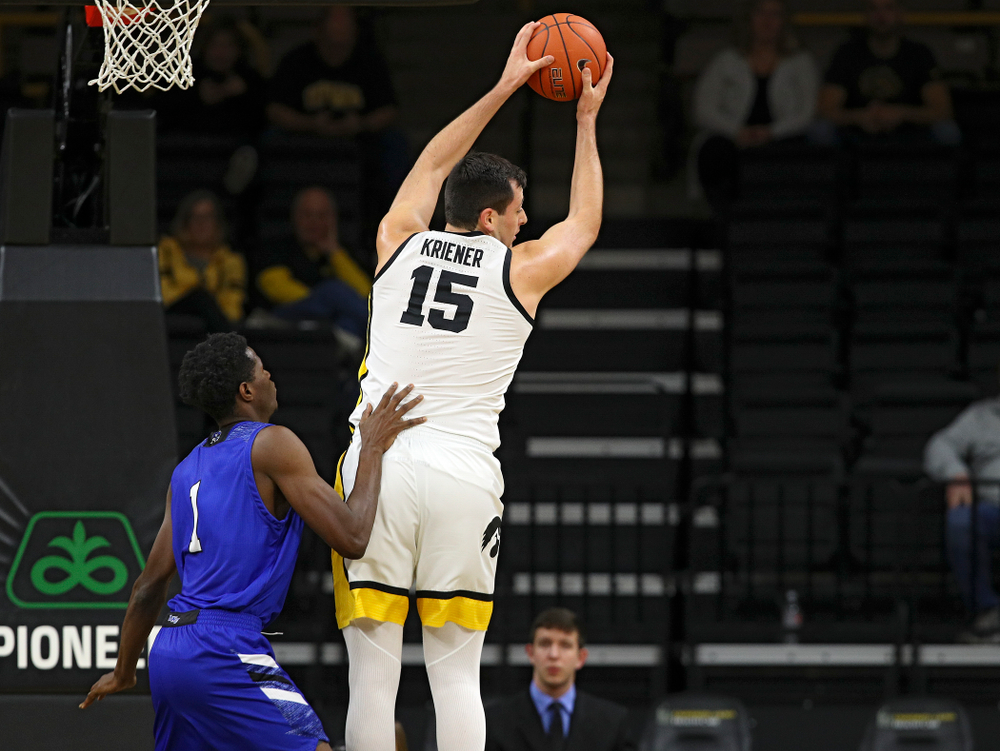 Iowa Hawkeyes forward Ryan Kriener (15) pulls down a rebound during the first half of their exhibition game against Lindsey Wilson College at Carver-Hawkeye Arena in Iowa City on Monday, Nov 4, 2019. (Stephen Mally/hawkeyesports.com)