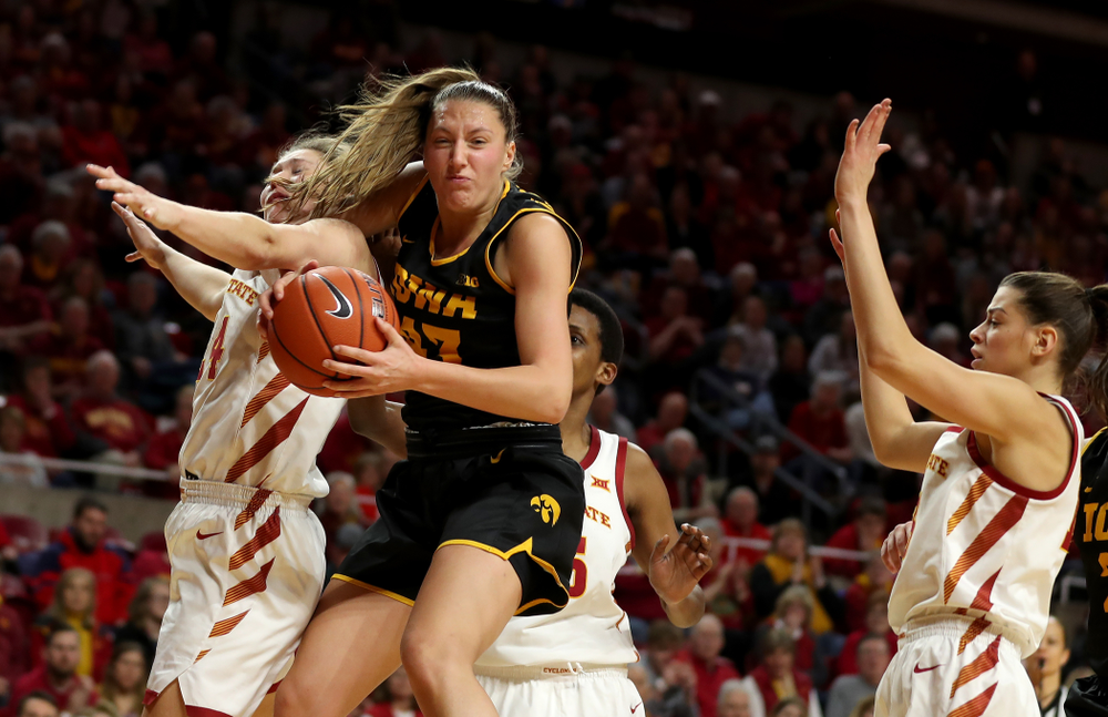 Iowa Hawkeyes forward Amanda Ollinger (43) grabs a rebound against the Iowa State Cyclones Wednesday, December 11, 2019 at Hilton Coliseum in Ames, Iowa(Brian Ray/hawkeyesports.com)
