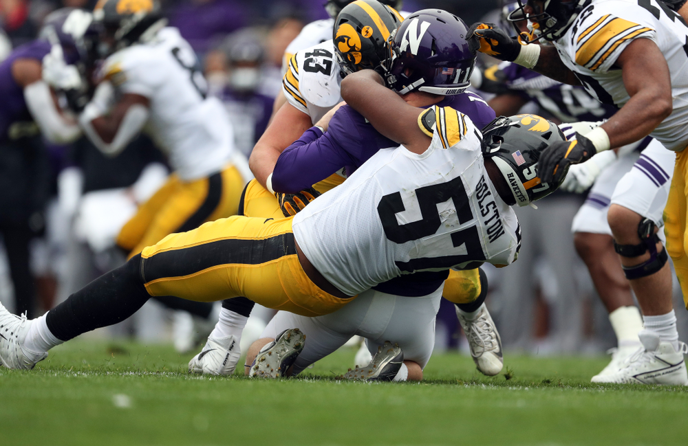 Iowa Hawkeyes linebacker Dillon Doyle (43) and defensive end Chauncey Golston (57) against the Northwestern Wildcats Saturday, October 26, 2019 at Ryan Field in Evanston, Ill. (Brian Ray/hawkeyesports.com)