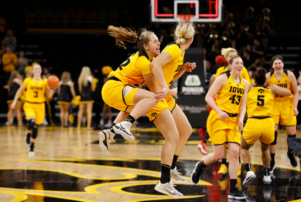 Iowa Hawkeyes guard Kathleen Doyle (22) and forward Hannah Stewart (21)