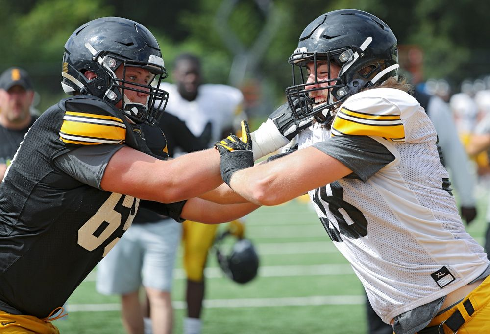 Iowa Hawkeyes offensive lineman Tyler Endres (69) and defensive lineman Chris Reames (98) run a drill during Fall Camp Practice No. 10 at the Hansen Football Performance Center in Iowa City on Tuesday, Aug 13, 2019. (Stephen Mally/hawkeyesports.com)