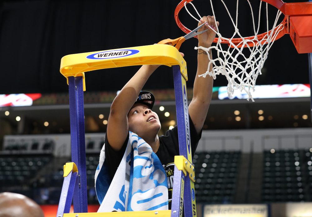 Iowa Hawkeyes guard Tania Davis (11) cuts down the net as they celebrate their victory over the Maryland Terrapins in the Big Ten Championship Game Sunday, March 10, 2019 at Bankers Life Fieldhouse in Indianapolis, Ind. (Brian Ray/hawkeyesports.com)