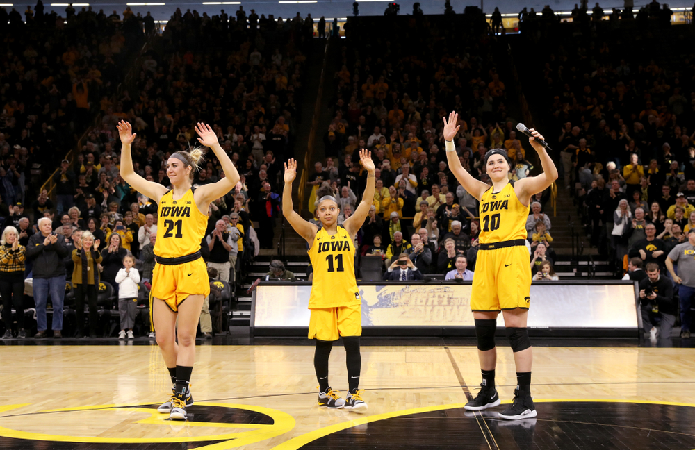 Iowa Hawkeyes seniors Hannah Stewart, Tania Davis, and Megan Gustafson wave to the fans during senior day ceremonies following their game against the Northwestern Wildcats Sunday, March 3, 2019 at Carver-Hawkeye Arena. (Brian Ray/hawkeyesports.com)