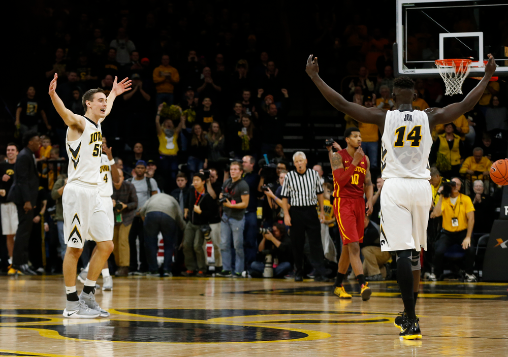 Iowa Hawkeyes guard Peter Jok (14), Iowa Hawkeyes forward Nicholas Baer (51)
