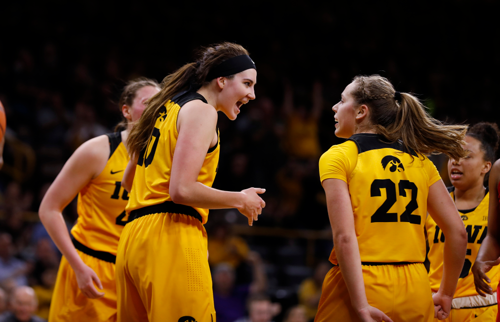 Iowa Hawkeyes forward Megan Gustafson (10) and guard Kathleen Doyle (22)