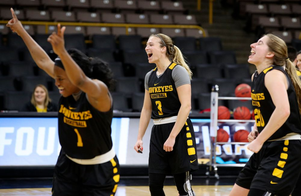 Iowa Hawkeyes guard Tomi Taiwo (1), guard Makenzie Meyer (3), and guard Kate Martin (20) celebrate at a practice during the 2019 NCAA Women's Basketball Tournament at Carver Hawkeye Arena in Iowa City on Saturday, Mar. 23, 2019. (Stephen Mally for hawkeyesports.com)