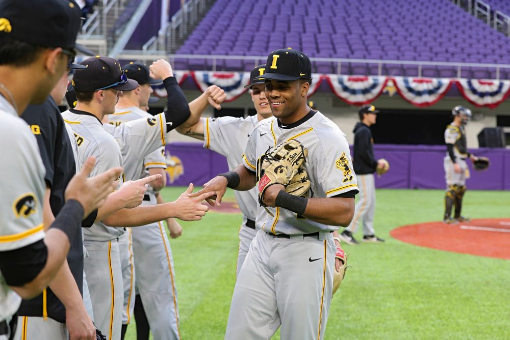 Iowa Hawkeyes infielder Lorenzo Elion (1) comes off the fielder after warming up before their CambriaCollegeClassic game at U.S. Bank Stadium in Minneapolis, Minn. on Friday, February 28, 2020. (Stephen Mally/hawkeyesports.com)