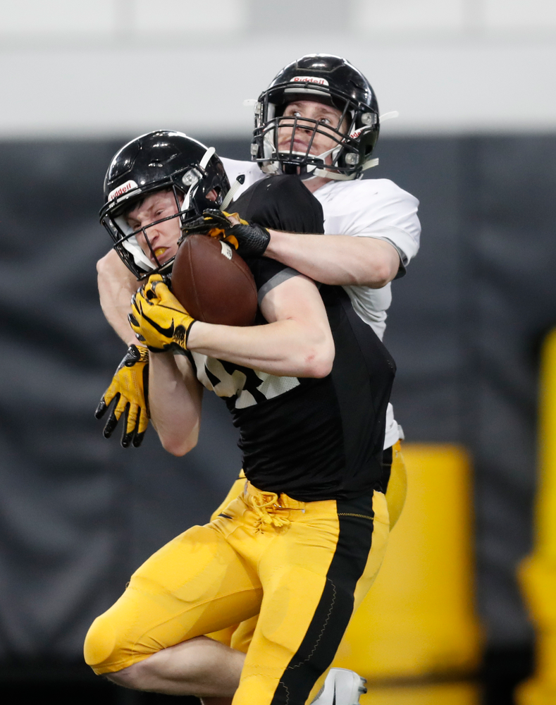 Iowa Hawkeyes wide receiver Drew Thomas (41)  and defensive back John Milani (18) during spring practice  Thursday, March 29, 2018 at the Hansen Football Performance Center. (Brian Ray/hawkeyesports.com)
