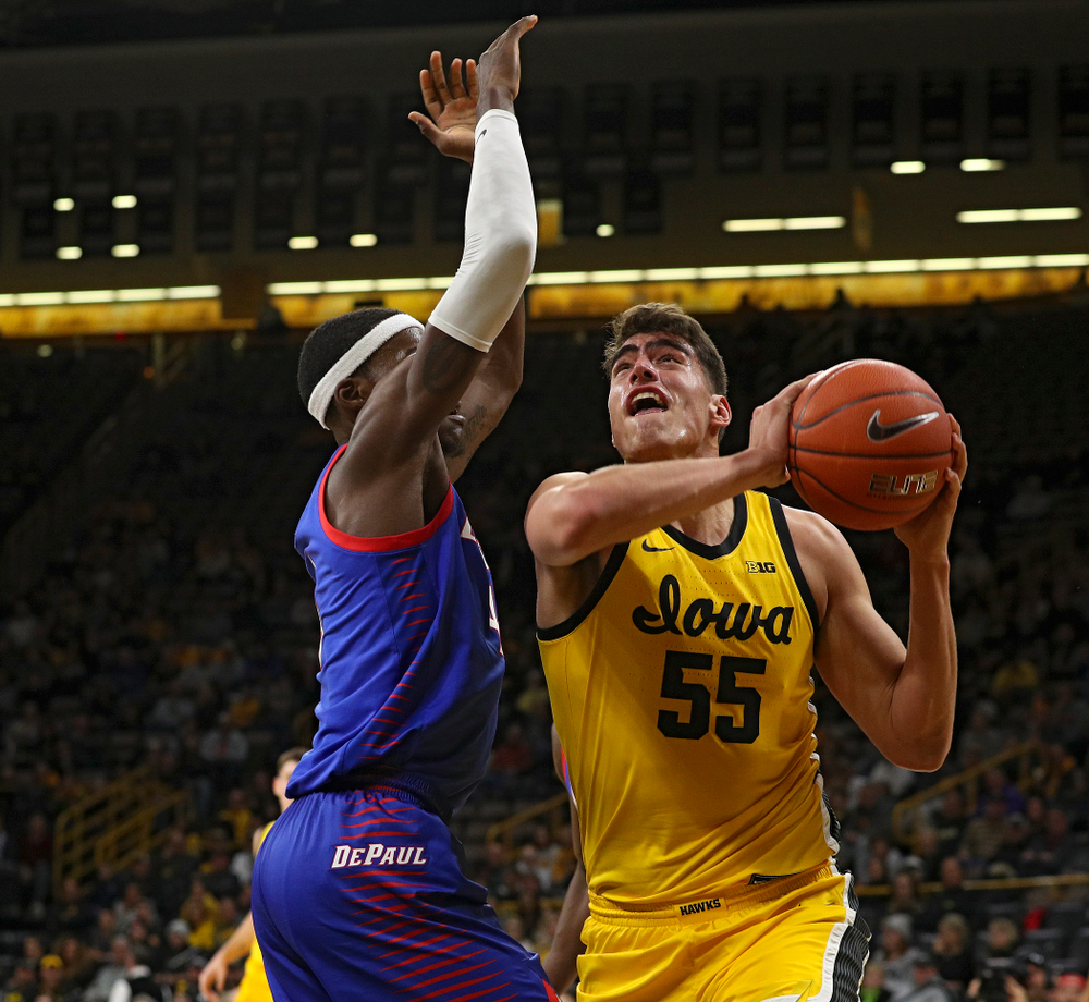 Iowa Hawkeyes center Luka Garza (55) fights to the basket during the first half of their game at Carver-Hawkeye Arena in Iowa City on Monday, Nov 11, 2019. (Stephen Mally/hawkeyesports.com)