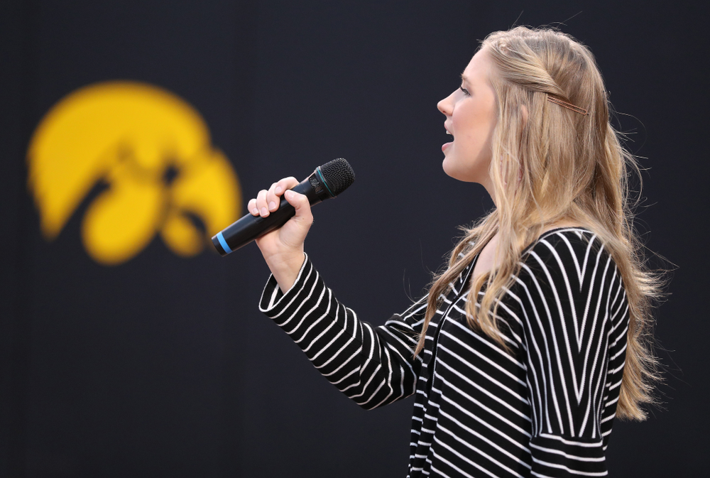 Emma Bluder sings the National Anthem before the Iowa Hawkeyes game against Western Illinois Wednesday, March 27, 2019 at Pearl Field. (Brian Ray/hawkeyesports.com)