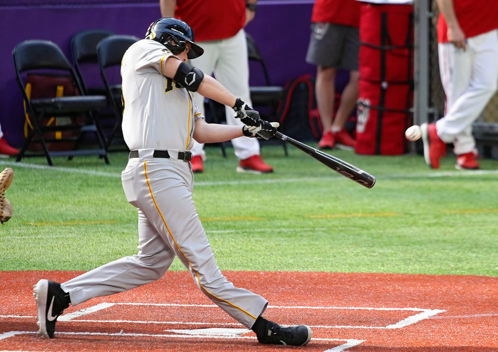 Iowa Hawkeyes first baseman Peyton Williams (45) drives a pitch for a double during the fifth inning of their CambriaCollegeClassic game at U.S. Bank Stadium in Minneapolis, Minn. on Friday, February 28, 2020. (Stephen Mally/hawkeyesports.com)