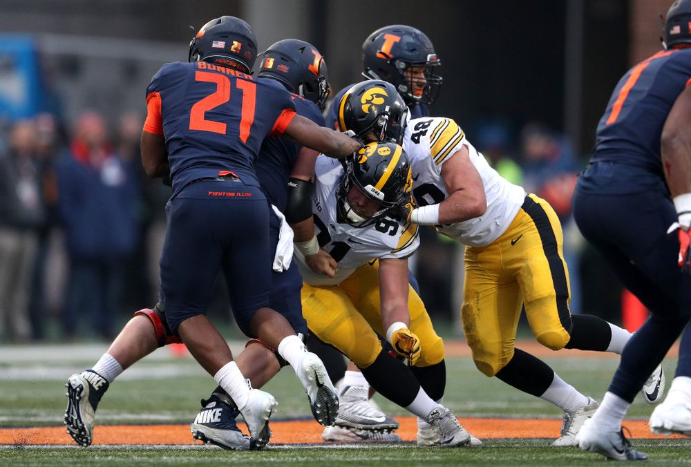 Iowa Hawkeyes defensive lineman Brady Reiff (91) and linebacker Jack Hockaday (48) against the Illinois Fighting Illini Saturday, November 17, 2018 at Memorial Stadium in Champaign, Ill. (Brian Ray/hawkeyesports.com)