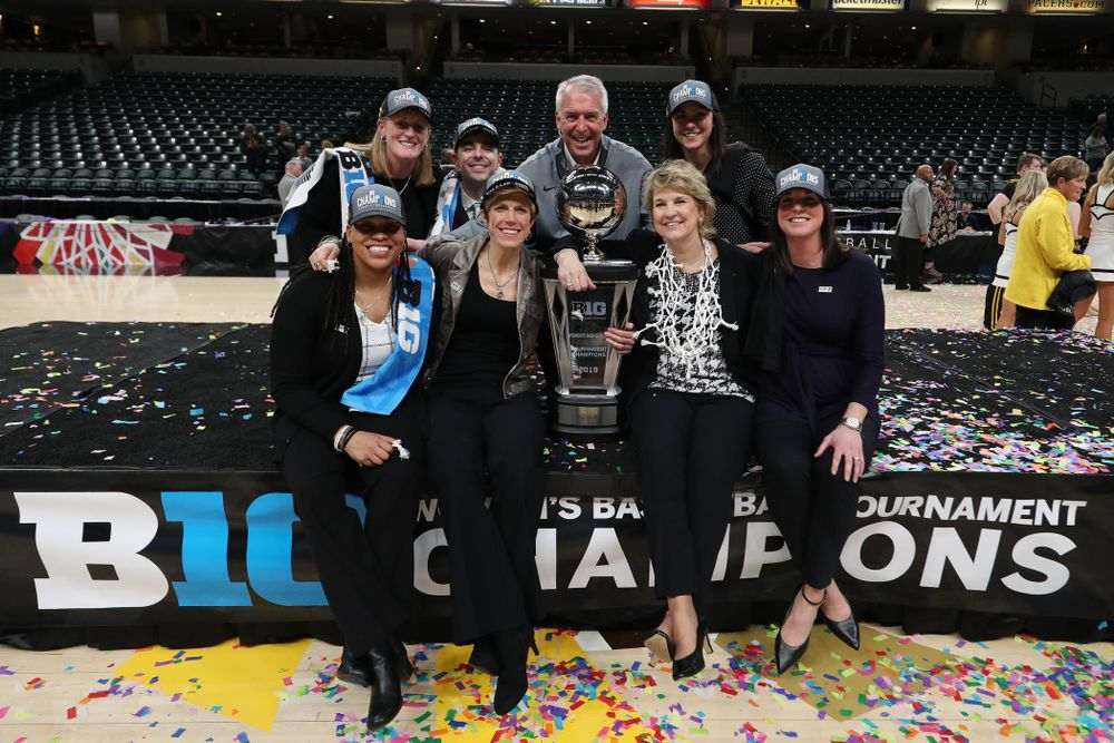 The Iowa Women's Basketball Coaching Staff with athletics director Gary Barta against the Maryland Terrapins Sunday, March 10, 2019 at Bankers Life Fieldhouse in Indianapolis, Ind. (Brian Ray/hawkeyesports.com)