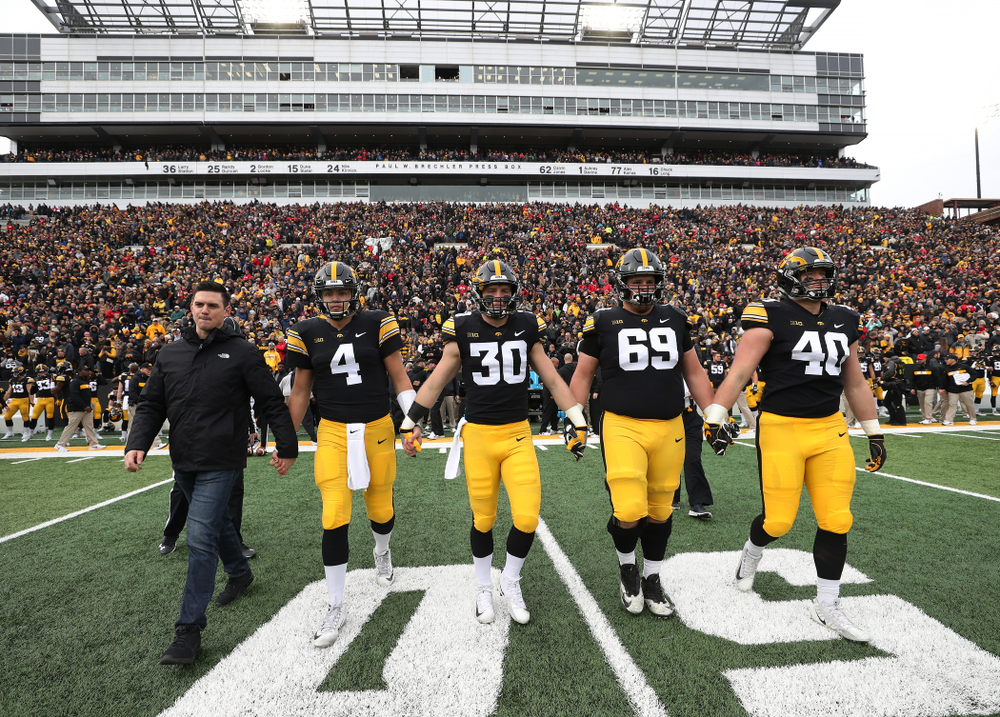 Iowa Hawkeyes captains James Morris, quarterback Nate Stanley (4), defensive back Jake Gervase (30), offensive lineman Keegan Render (69), and defensive end Parker Hesse (40) before their game against the Nebraska Cornhuskers Friday, November 23, 2018 at Kinnick Stadium. (Brian Ray/hawkeyesports.com)