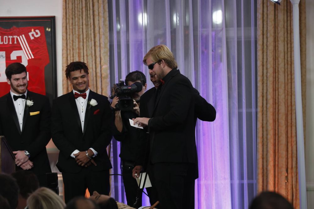 USC long-snapper Jake Olson, who is blind, announces the winners' name that was on a special envelope in braille.