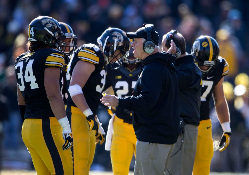 Iowa Hawkeyes defensive line coach Reese Morgan talks with defensive end Nate Meier (34) during the first half of their game against the Northwestern Wildcats Saturday, Nov. 1, 2014 at Kinnick Stadium.  (Brian Ray/hawkeyesports.com)