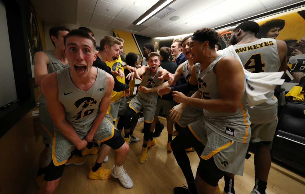 The Iowa Hawkeyes celebrate their victory against the Iowa State Cyclones in the Iowa Corn Cy-Hawk Series Thursday, December 6, 2018 at Carver-Hawkeye Arena. (Brian Ray/hawkeyesports.com)