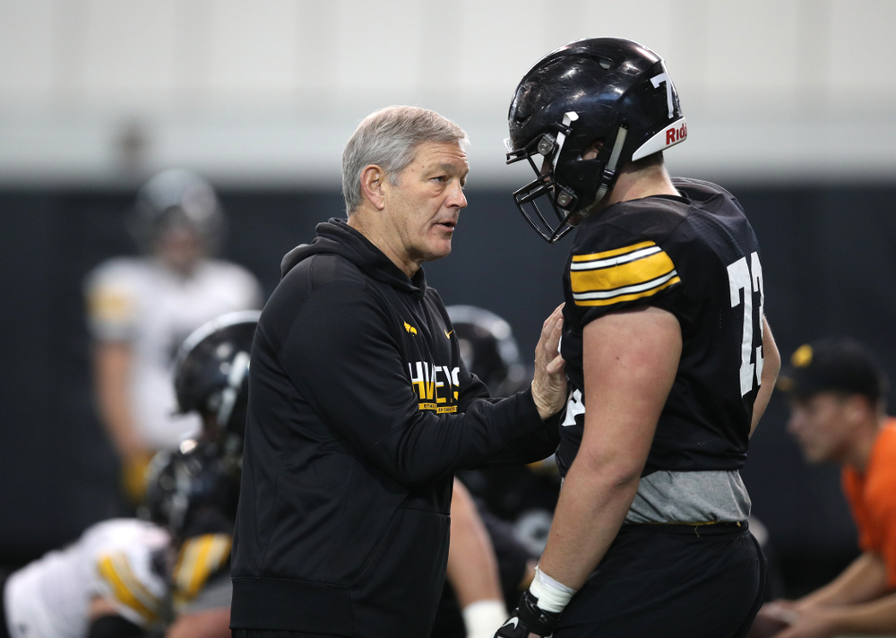 Iowa Hawkeyes head coach Kirk Ferentz and offensive lineman Cody Ince (73) during preparation for the 2019 Outback Bowl Monday, December 17, 2018 at the Hansen Football Performance Center. (Brian Ray/hawkeyesports.com)