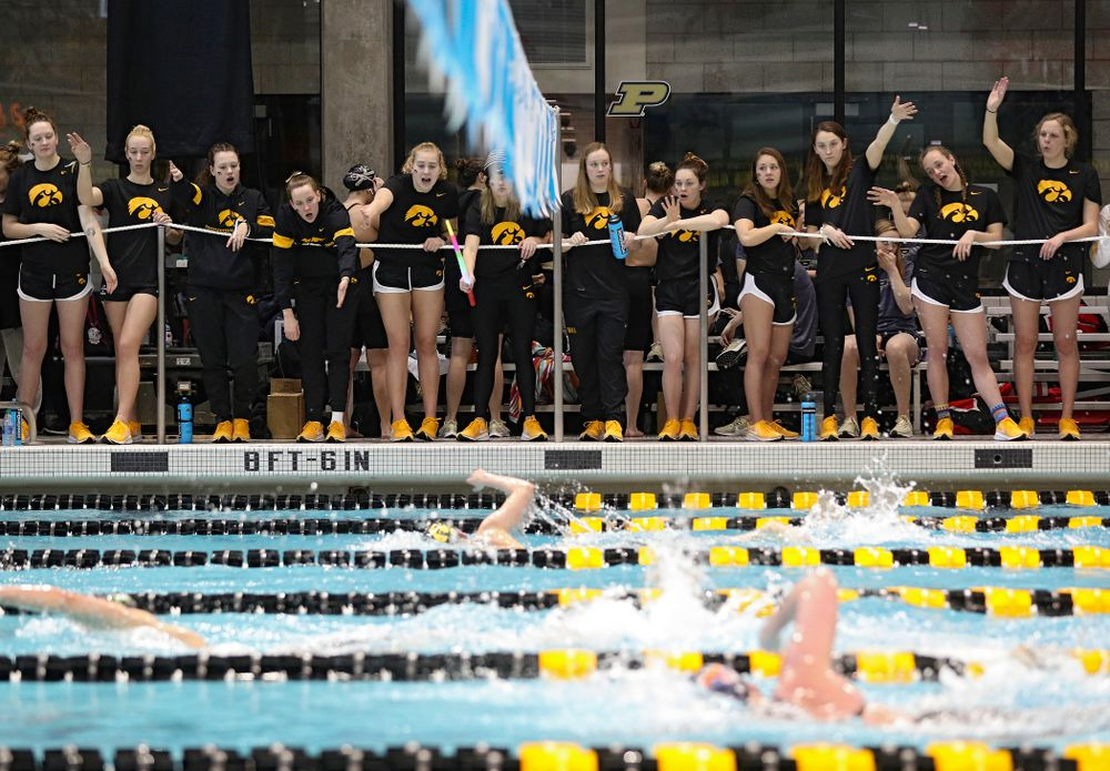 Teammates cheer on Taylor Hartley as she swims the women's 1650 yard freestyle event during the 2020 Women's Big Ten Swimming and Diving Championships at the Campus Recreation and Wellness Center in Iowa City on Saturday, February 22, 2020. (Stephen Mally/hawkeyesports.com)