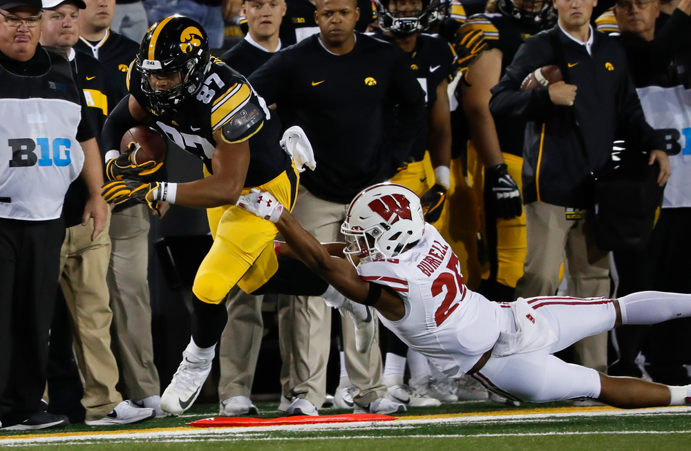 Iowa Hawkeyes tight end Noah Fant (87) is run out of bounds after making a first down reception during a game against Wisconsin at Kinnick Stadium on September 22, 2018. (Tork Mason/hawkeyesports.com)