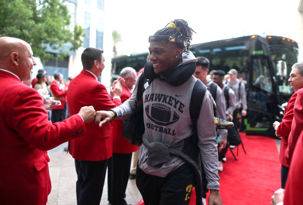 Iowa Hawkeyes wide receiver Brandon Smith (12) shakes hands with the ÒRed CoatsÓ after arriving in San Diego, CA Saturday, December 21, 2019 for the Holiday Bowl. (Brian Ray/hawkeyesports.com)