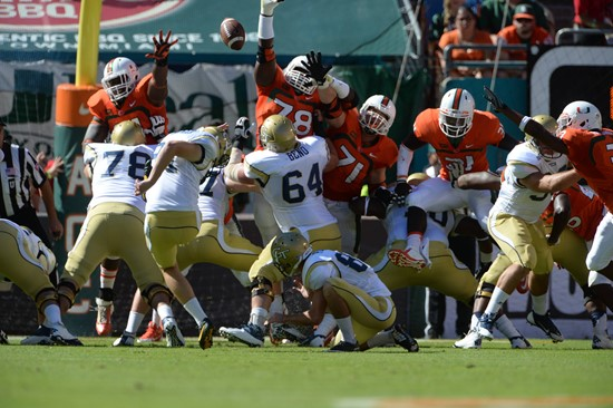 University of Miami Hurricanes defensive lineman Justin Renfrow #78 gets set to block against the Georgia Tech Yellow Jackets at Sun Life Stadium on...