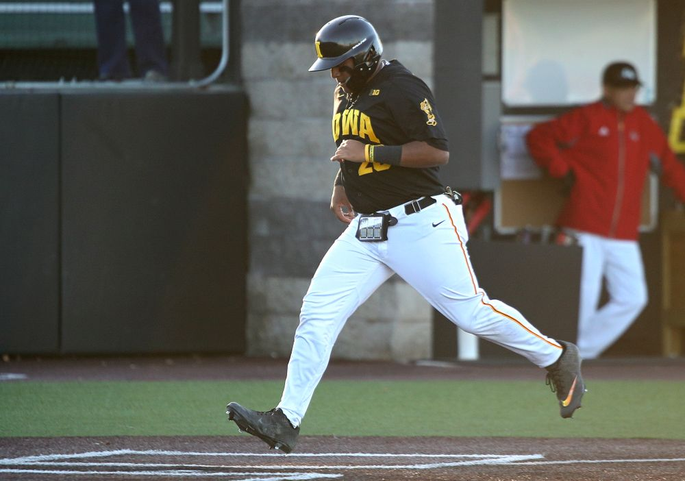 Iowa infielder Izaya Fullard (20) scores a run during the third inning of their game at Duane Banks Field in Iowa City on Tuesday, March 3, 2020. (Stephen Mally/hawkeyesports.com)