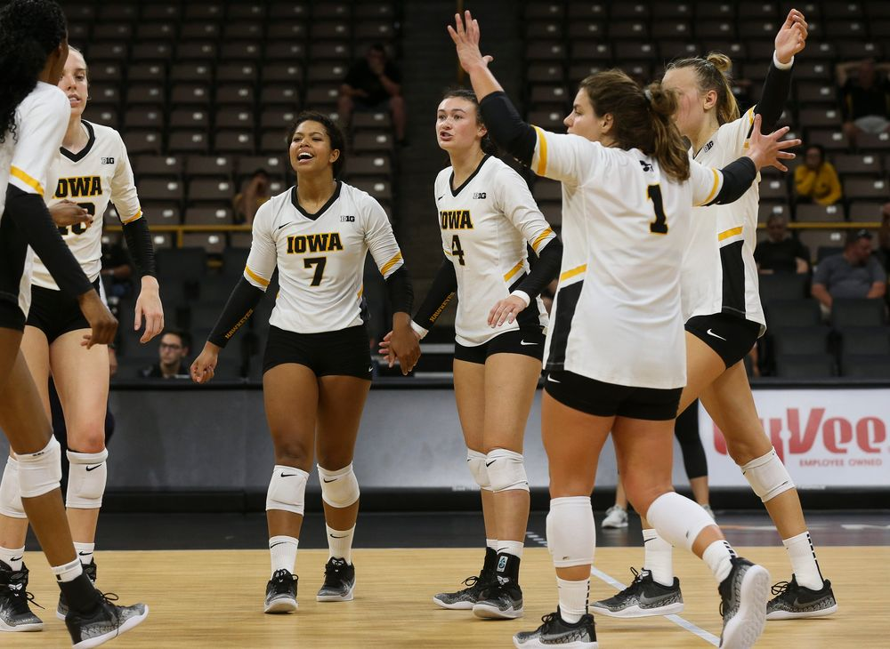 Iowa Hawkeyes setter Brie Orr (7), Iowa Hawkeyes defensive specialist Halle Johnston (4)