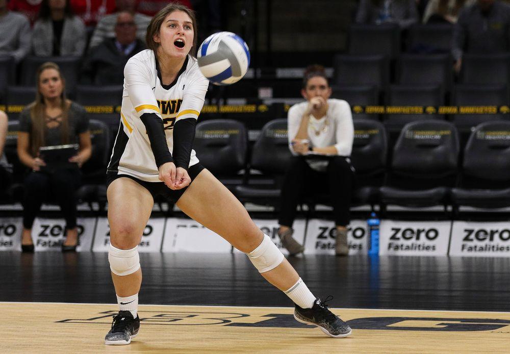 Iowa Hawkeyes defensive specialist Emily Bushman (12) bumps the ball during a match against Nebraska at Carver-Hawkeye Arena on November 7, 2018. (Tork Mason/hawkeyesports.com)