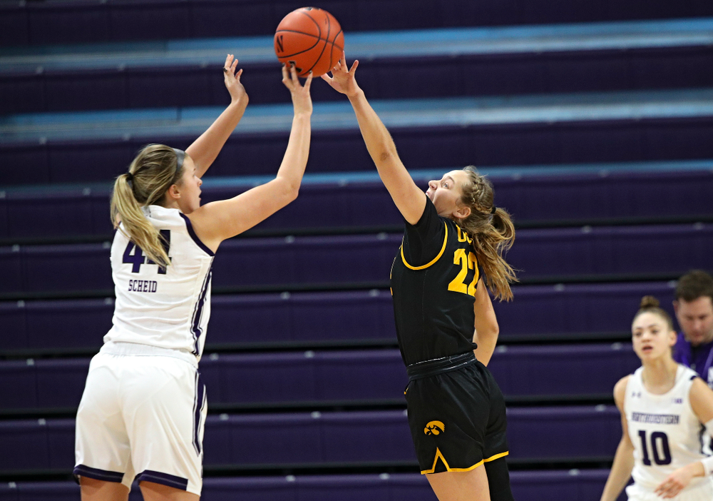 Iowa Hawkeyes guard Kathleen Doyle (22) tries to reach a shot during the first quarter of their game at Welsh-Ryan Arena in Evanston, Ill. on Sunday, January 5, 2020. (Stephen Mally/hawkeyesports.com)
