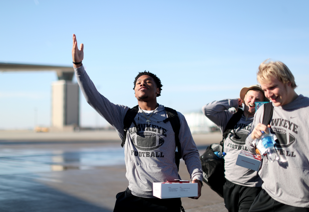 Iowa Hawkeyes wide receiver Tyrone Tracy Jr. (3) boards the team plane at the Eastern Iowa Airport Saturday, December 21, 2019 on the way to San Diego, CA for the Holiday Bowl. (Brian Ray/hawkeyesports.com)