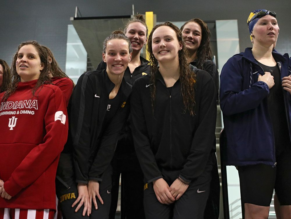 Iowa's Hannah Burvill, Allyssa Fluit, Emilia Sansome, and Macy Rink on the podium after placing fourth in the 800 yard freestyle relay event during the 2020 Big Ten Women's Swimming and Diving Championships at the Campus Recreation and Wellness Center in Iowa City on Wednesday, February 19, 2020. (Stephen Mally/hawkeyesports.com)